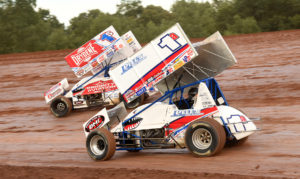Logan Schuchart and Jacob Allen race side by side in their Shark Racing cars
