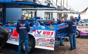 The Rocket1 Racing team works on the car at Jackson Motorplex
