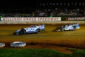 Gregg Satterlee and Kyle Larson battle for the lead