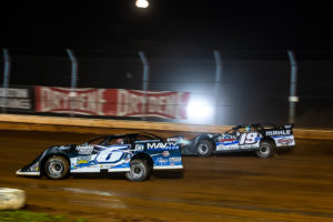 Larson and Gustin battle for the lead