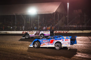 Chris Madden and Brandon Sheppard race for position