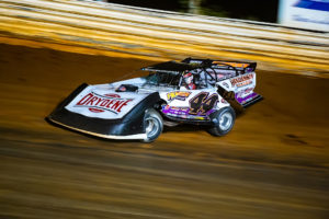 Madden survives to finish second